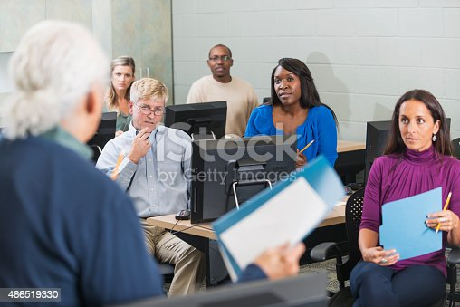 876965270 istock photo Group of adults taking continuing education class 466519330