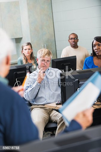 876965270 istock photo Group of adults taking continuing education class 536018733
