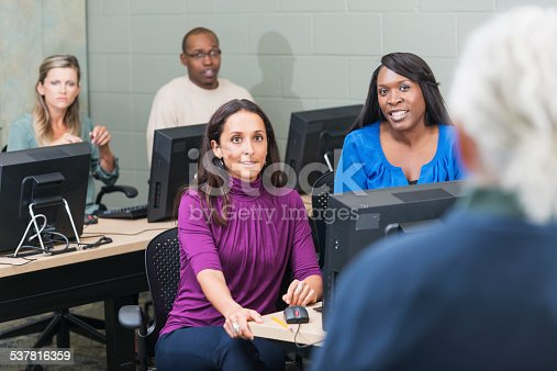 876965270 istock photo Group of adults taking continuing education class 537816359