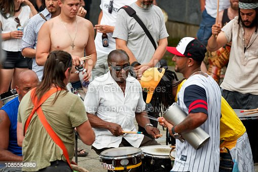 Montreal, Canada - June, 2018. African American, Latin, and Caucasian drummers and percussionists play rhythm at Tam Tams festival in Mount Royal Park, Montreal, Quebec, Canada. Editorial use.