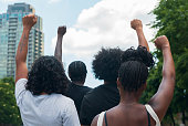 A group of African American people protest racial injustice in light of protest.