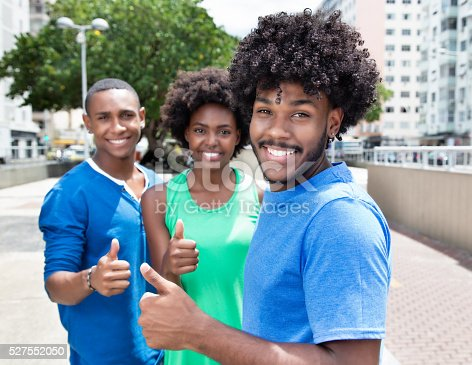 istock Group of african american young adults showing thumb 527552050