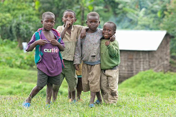 group of african boys standing beside the road, north-kivu, congo - democratic republic of the congo stock photos and pictures