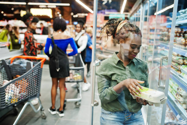 Group of african womans at supermarket stock photo