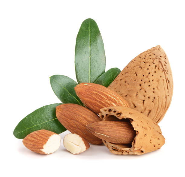 Group of almond nuts with leaves isolated on white background stock photo