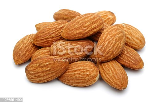 Group of almonds isolated on white background. Macro, studio shot.