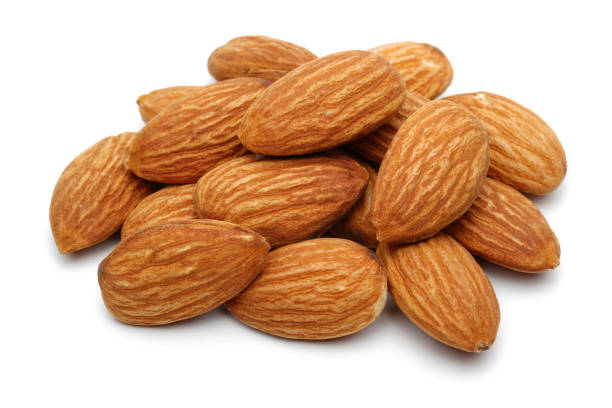 Group of almonds isolated on white background. Macro, studio shot. stock photo