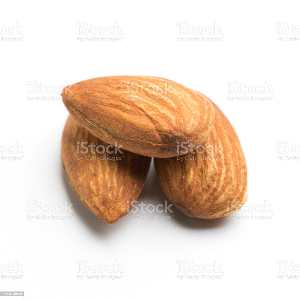 group of almonds isolated on white royalty-free stock photo