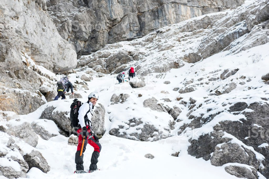 Alpinist on snow path