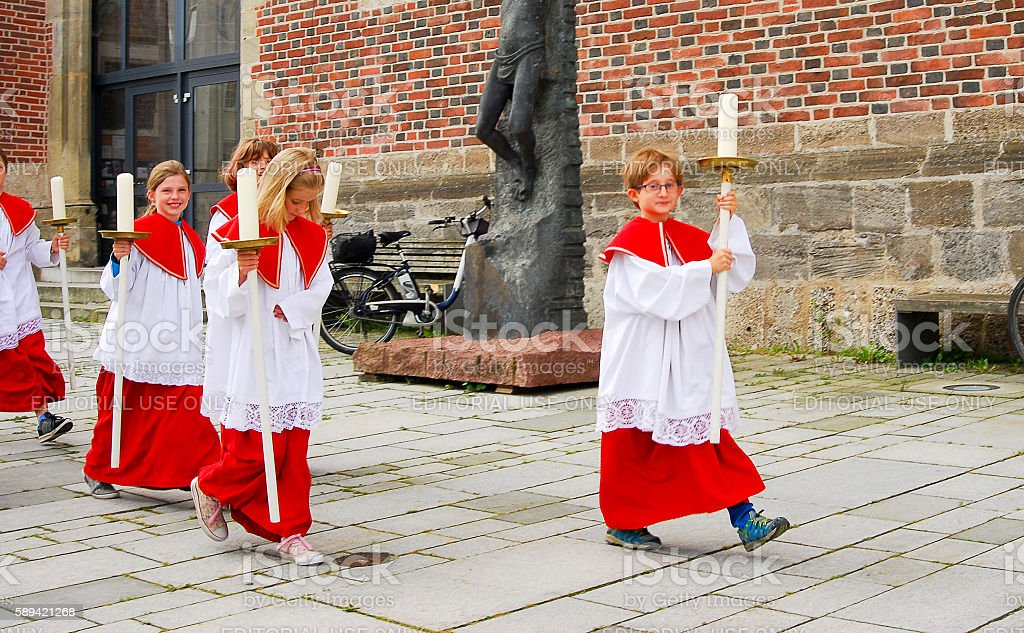 Group of Altar Boys proceed to church stock photo