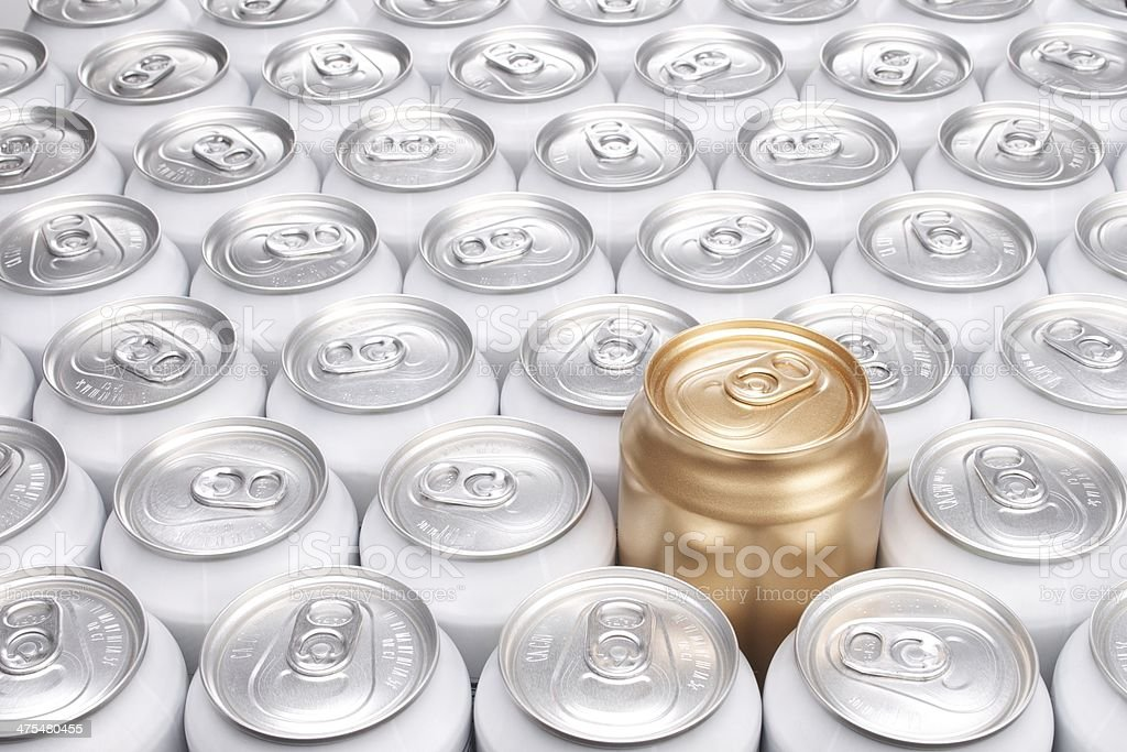 Group of Aluminum Beverage Cans with One Gold Can stock photo