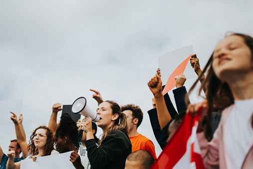 istock Group of American activists is protesting 1072338828