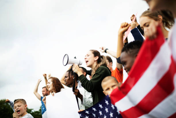 group of american activists is protesting - protestor stock pictures, royalty-free photos & images