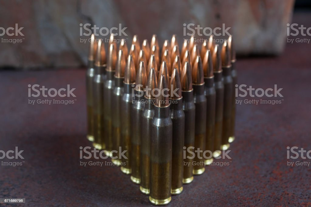 Group of  ammunition geometrically placed in rows stock photo