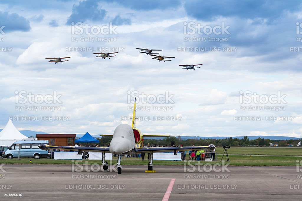Group of Antonov An-2 biplanes flying stock photo