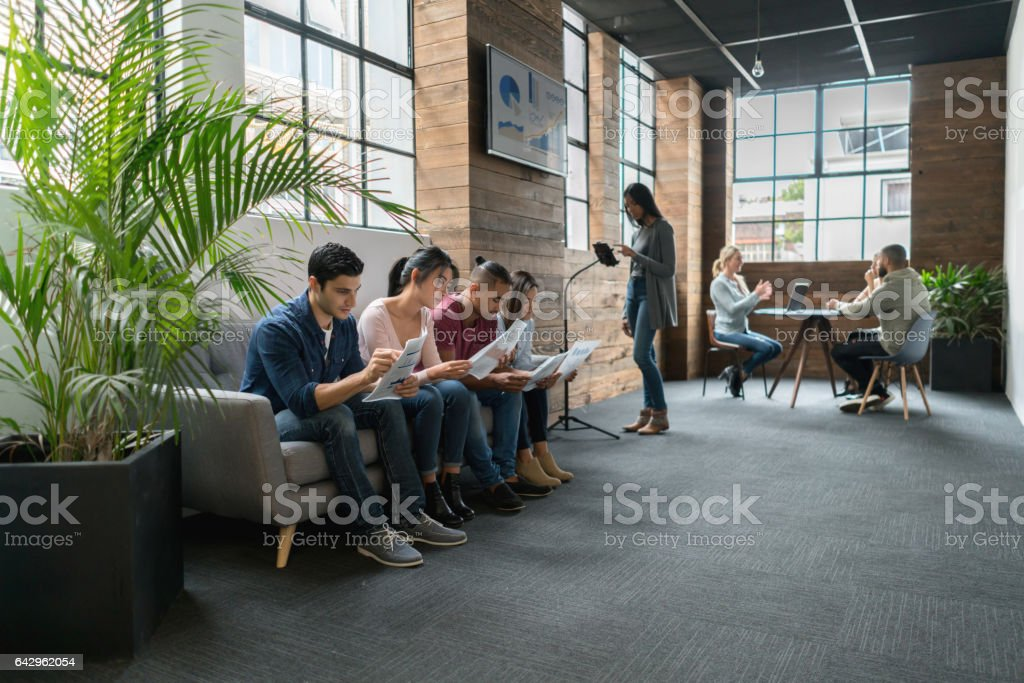 Group of applicants waiting for their turn for an interview stock photo