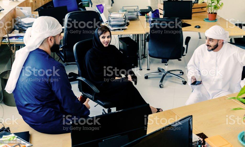 Arabs, Emirati, UAE, Dubai - Business Executives having casual...