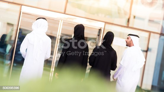 Group of Arab Business Professionals walking inside their office building. Image taken during iStockalypse 2015, Dubai, United Arab Emirates