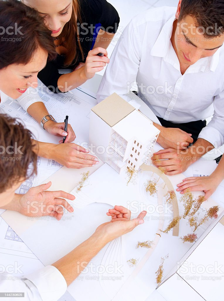 Group of architects discussing in an office royalty-free stock photo