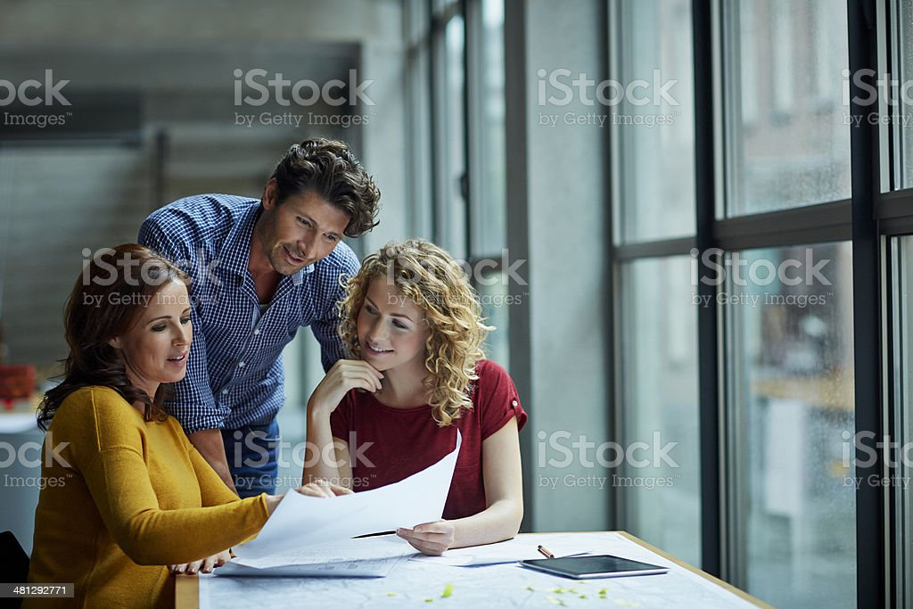 Group of architects discussing projects stock photo