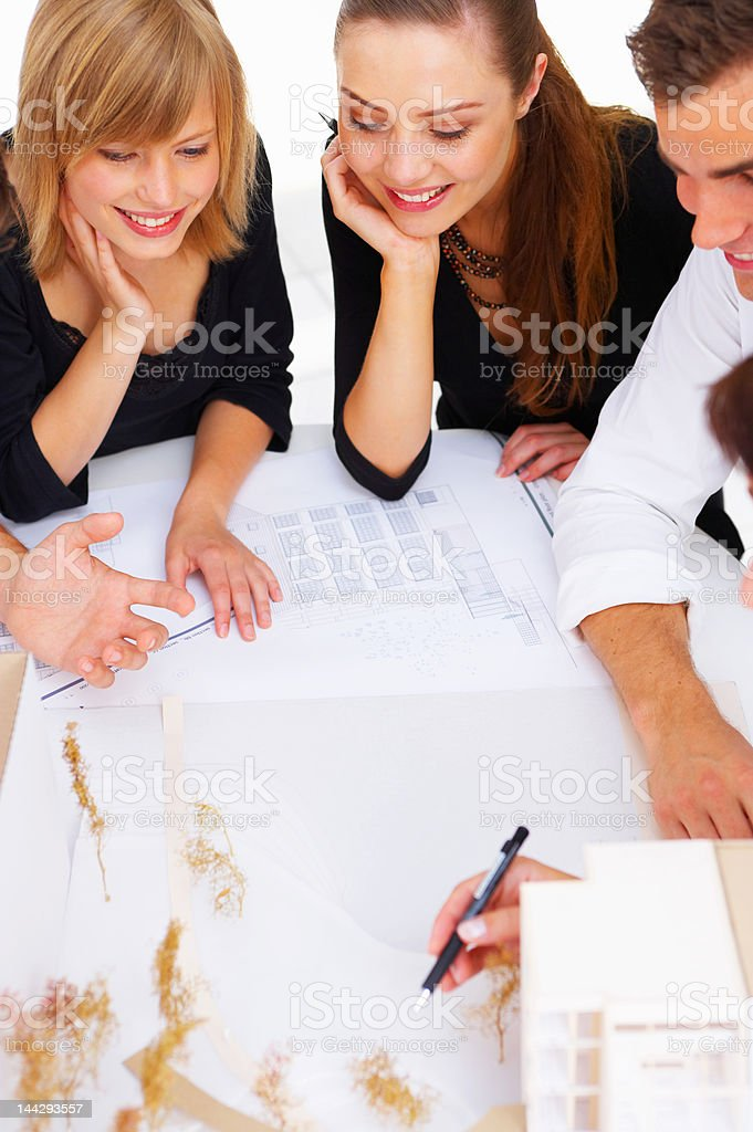 Group of architects discussing some new plans royalty-free stock photo