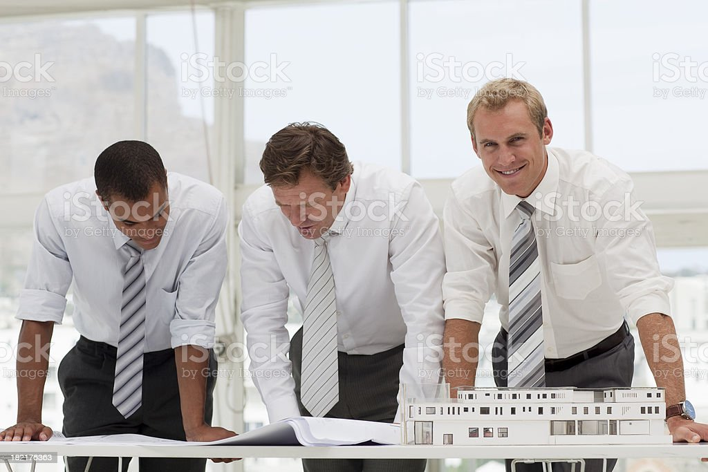 Group of Architects looking at plans royalty-free stock photo