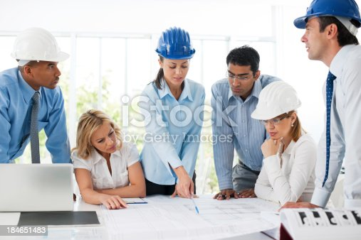 1166176793 istock photo Group of architects working on a project. 184651483