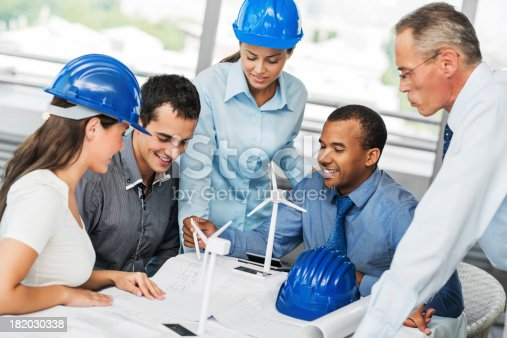 istock Group of architects working on a Wind Turbine project 182030338