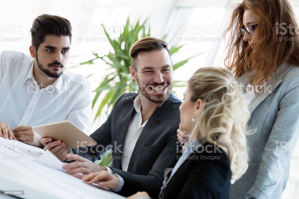 Group of architects working together on project royalty-free stock photo
