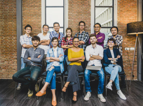 Group Of Asian and Multiethnic Business people with casual suit working in the modern Office, people business group concept stock photo