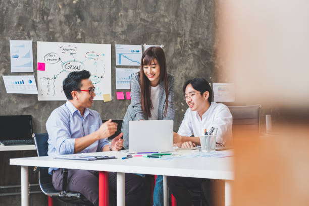 Group of Asian business people and creative designer meeting in office stock photo