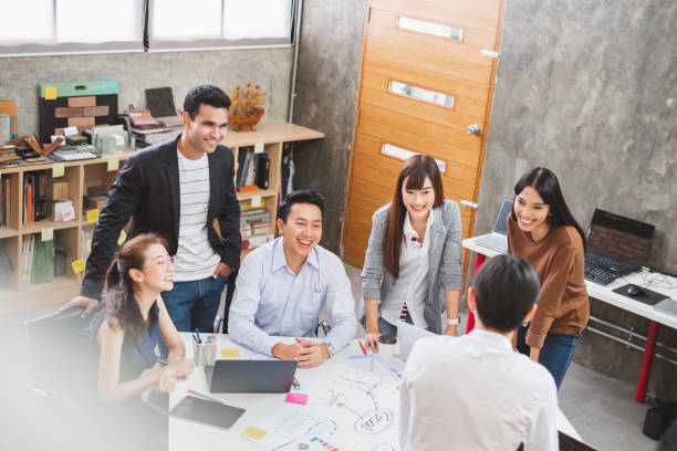 Group of Asian business people and creative designer meeting in office, top view stock photo