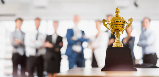 Group of Asian Business people celebrate for trophy, reward, winner, champion and teamwork successful concept Group of Asian Business people celebrate for trophy, reward, winner, champion and teamwork successful concept achievement stock pictures, royalty-free photos & images