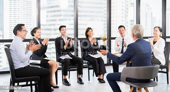 1016196912 istock photo Group of Asian Business people celebrate for trophy, reward, winner, champion and teamwork successful concept 1181006068