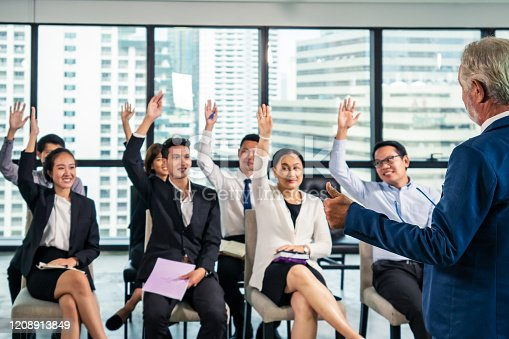 541975802 istock photo Group of Asian business people man and woman employee meeting and listening CEO manager speech or briefing and discussing business plan in office conference room. Business team meeting seminar concept. 1208913849