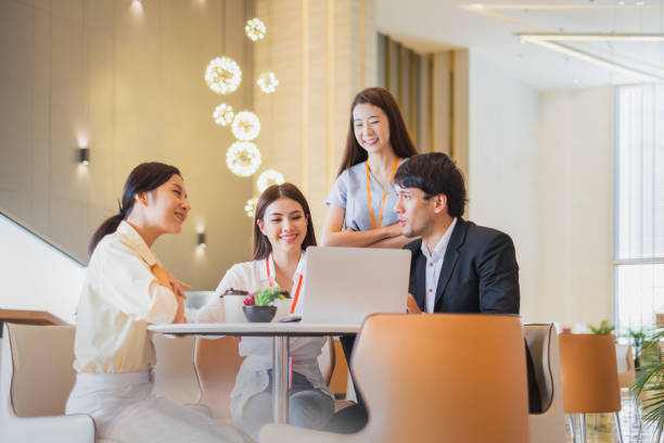 Group of Asian business people meeting in office stock photo