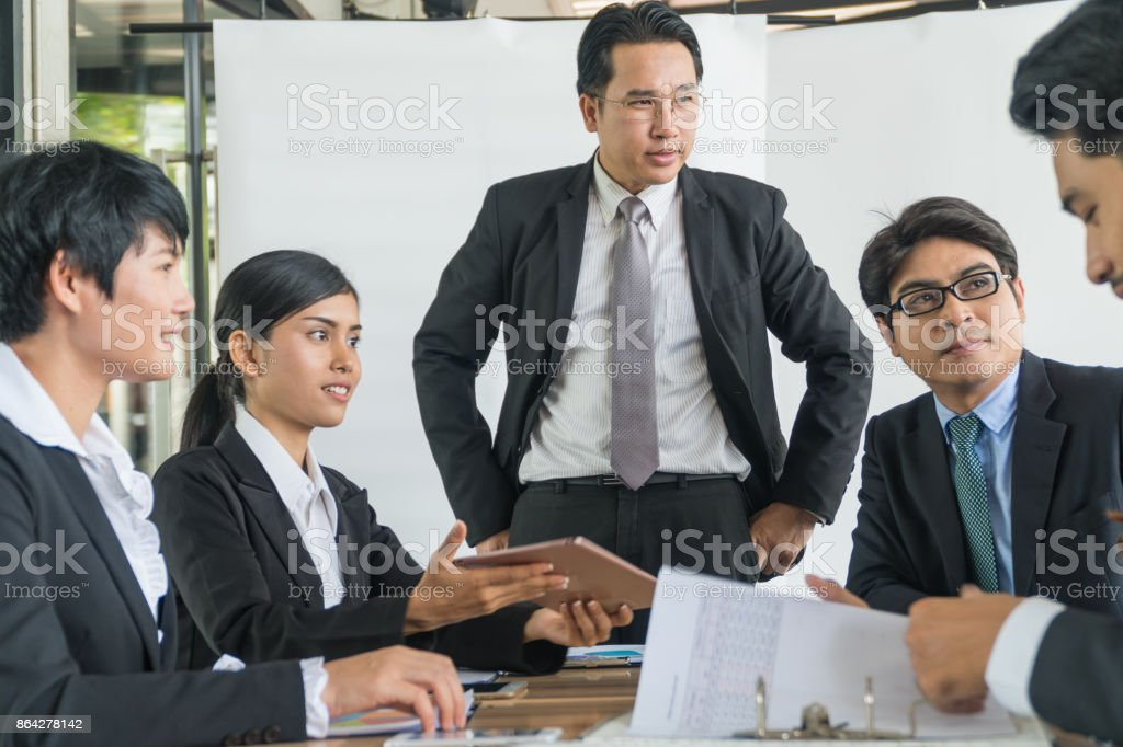 Group Of Asian Business people meeting with tablet in coffee shop.business group concept royalty-free stock photo