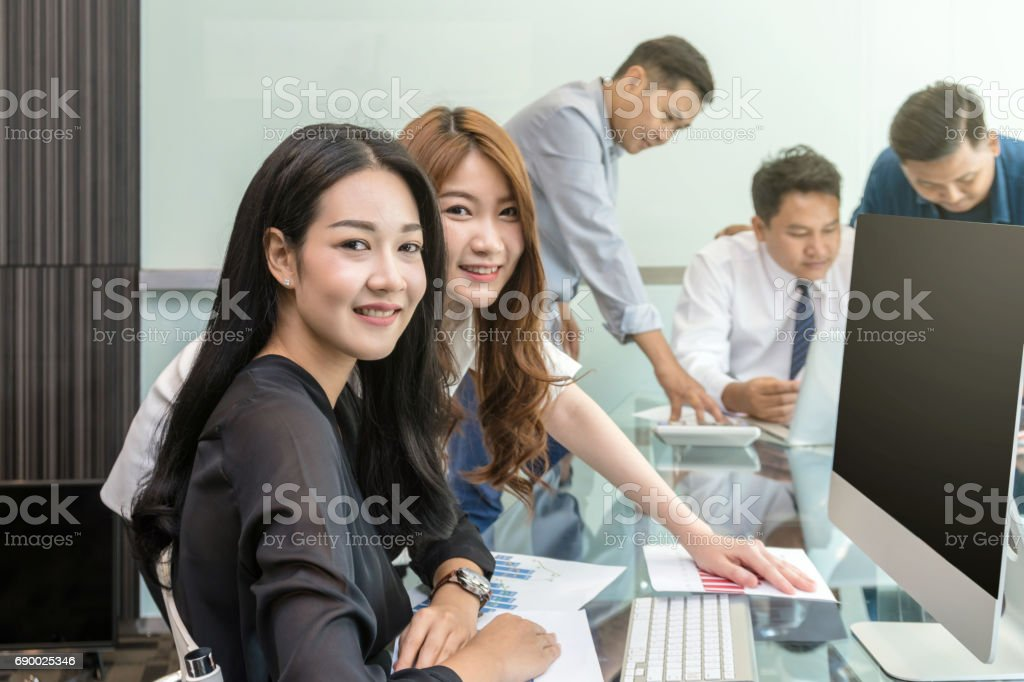 Group Of Asian Business people with casual suit working and talking together in the modern Office, people business group concept stock photo