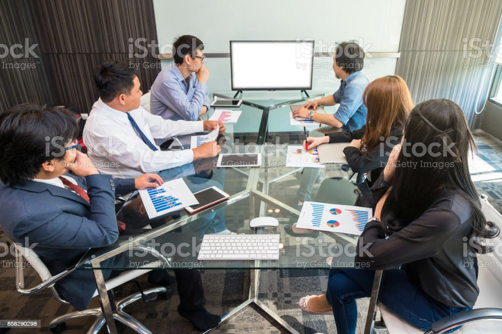 Group of asian Business team having video conference with monitor display in the modern conference room, Business people meeting concept stock photo