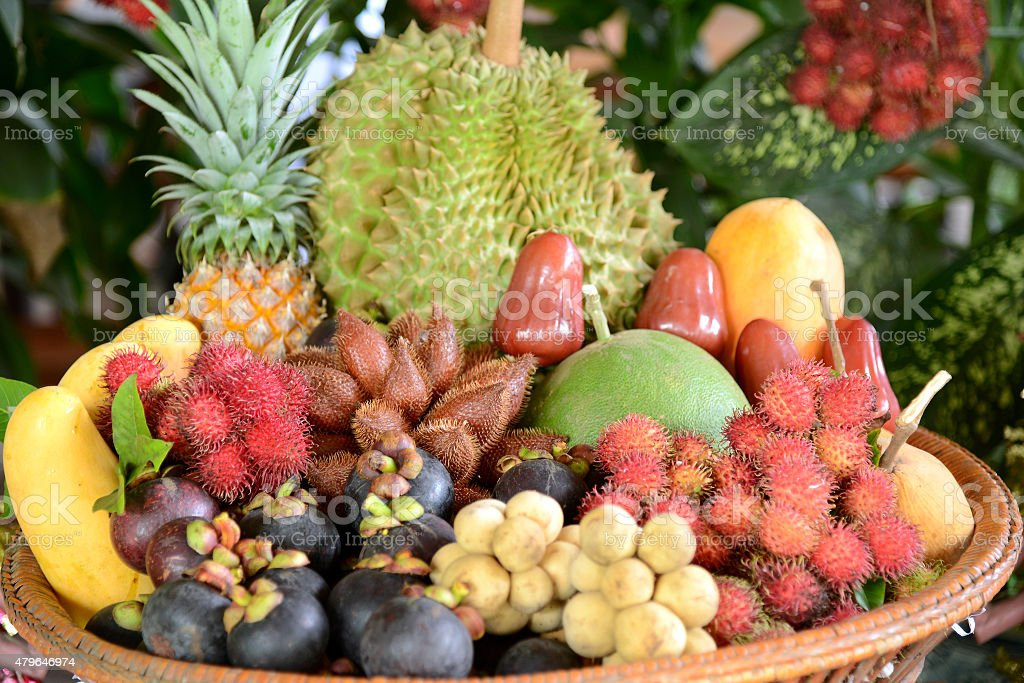 Group of Asian or Tropical fruit in basket, Thailand stock photo