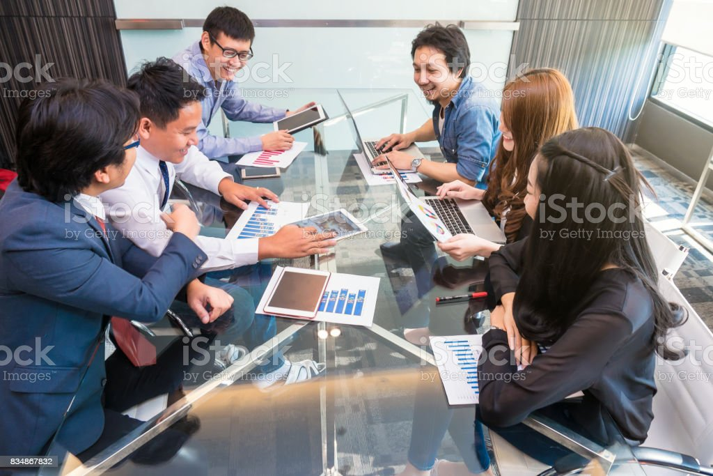 Group Of AsianBusiness people in casual suit working and meeting with happiness action in the modern Office, people business group concept stock photo