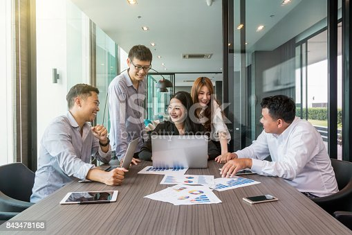 istock Group Of AsianBusiness people with casual suit working and brainstorming with happy action and celebrate in the modern Office, people business group concept 843478168