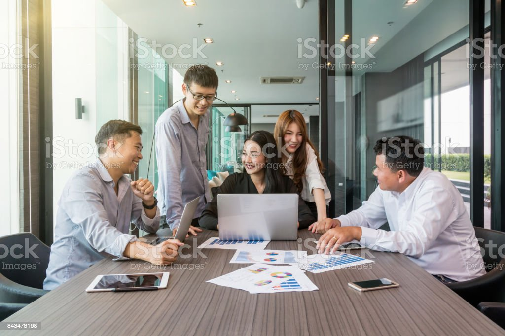 Group Of AsianBusiness people with casual suit working and brainstorming with happy action and celebrate in the modern Office, people business group concept stock photo