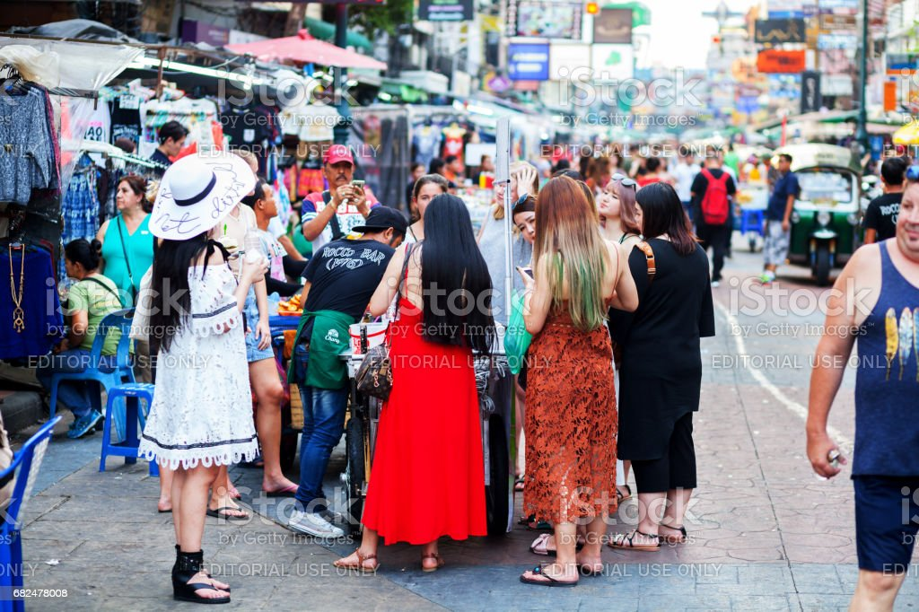 Group of asien tourists buying food in Khao San Road royalty-free stock photo