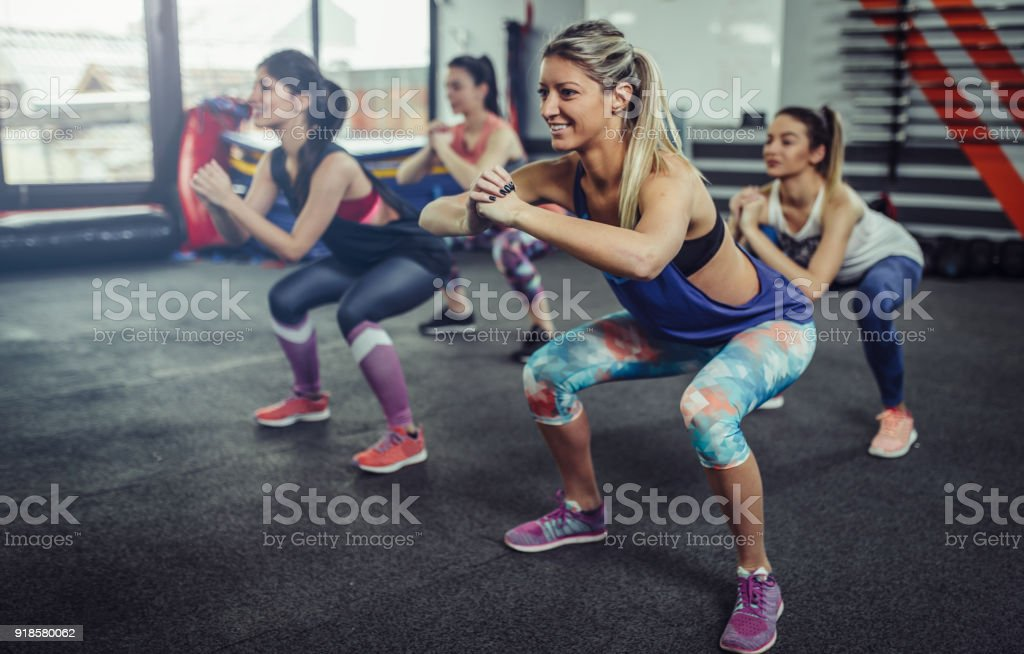 Group of athlete women exercising at the gym. Fitness women exercising at gym. stock photo
