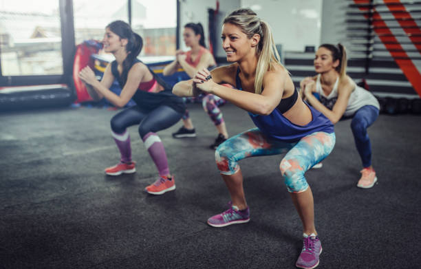 group of athlete women exercising at the gym. fitness women exercising at gym. - aerobics stock photos and pictures