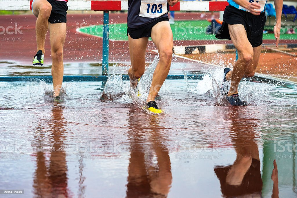 Group of Athletes at 3000 Metres Steeplechase stock photo