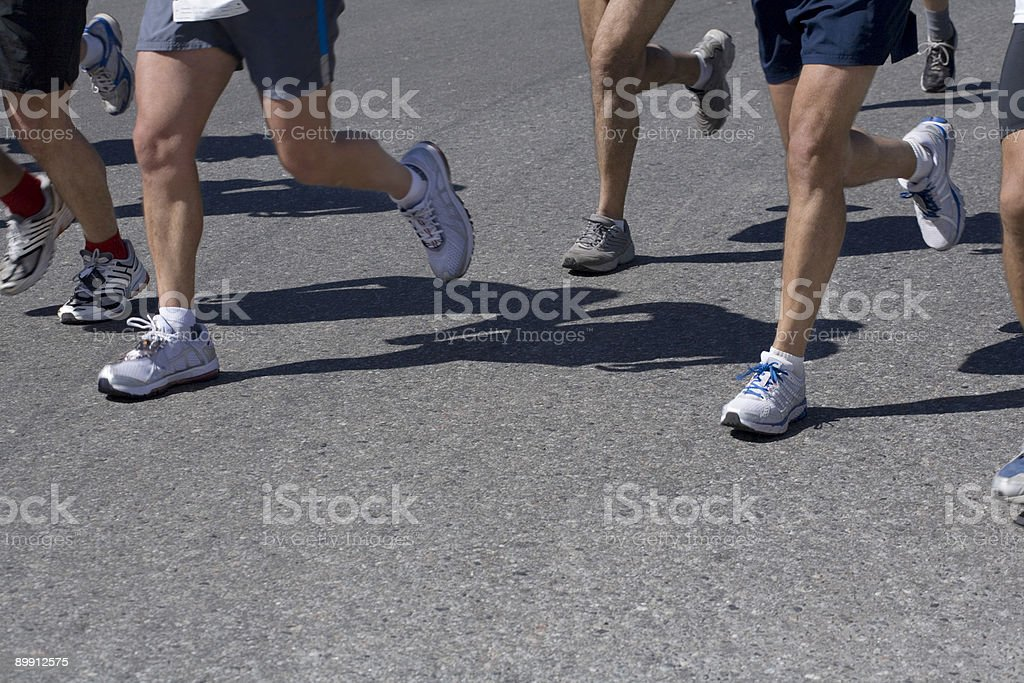 Group of athletes running in the city royalty-free stock photo