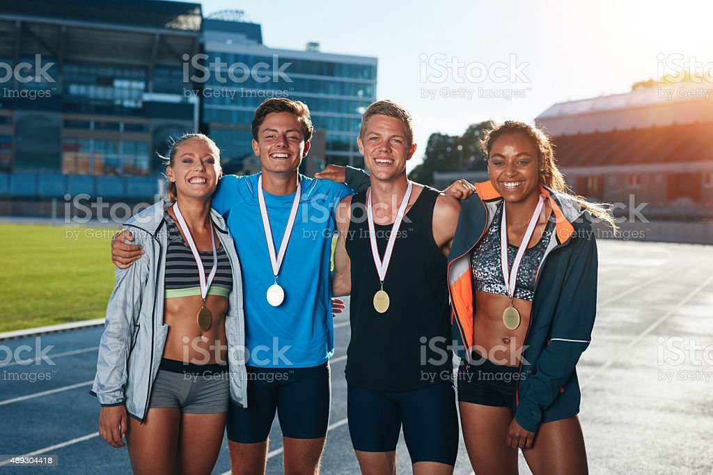 Group of athletes with medals stock photo