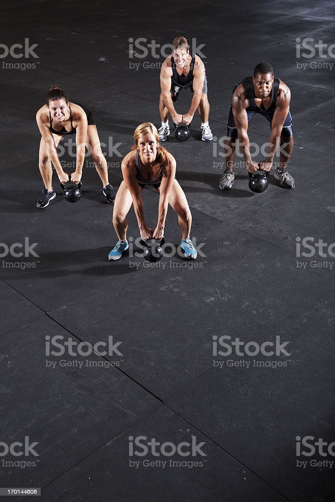 Group of athletes working out with kettle bells stock photo